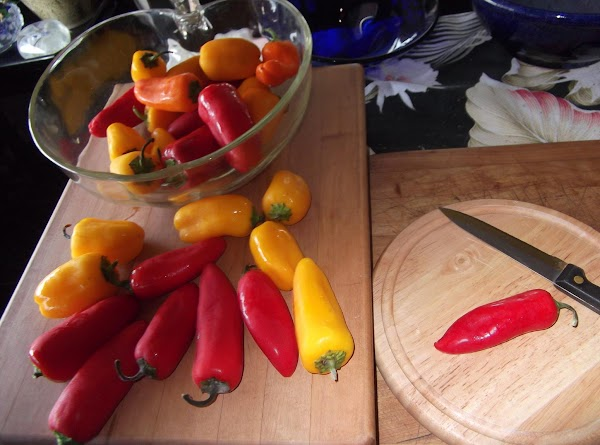 wash peppers, cut off stems, cut in half lengthwise, remove seeds.