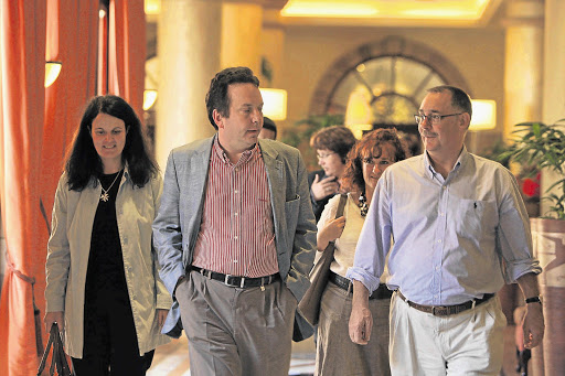 Auditor Lucas Venter with Advocate Billy Downer, right, and former Scorpions team leader Advocate Gerda Ferreira, centre, during a lunch break at the Arms Procurement Commission at the Sheraton Hotel in Pretoria yesterday Picture: KATHERINE MUICK-MERE