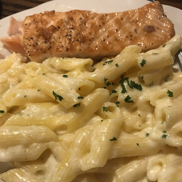 Fettuccine Alfredo penne with a side of salmon. Yum!