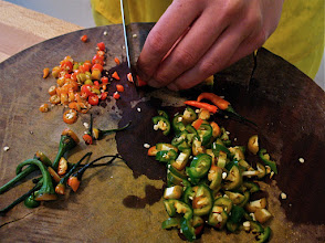 "Photo: cutting chillies for ""miang kam"" filling"