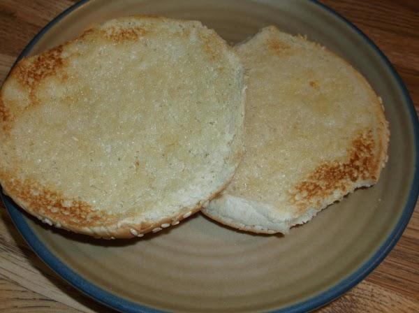 Toast bun halves in toaster oven on medium-light setting.