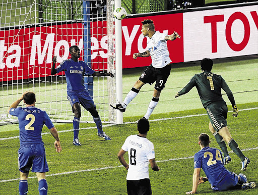 Paolo Guerrero of Brazil's Corinthians heads the ball past Chelsea's Ramires to score the only goal in the Fifa Club World Cup final in Yokohama, Japan. File photo