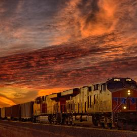 Twilight Train by Ryan Trullinger - Transportation Railway Tracks ( clouds, railroad tracks, dawn, twilight, train )