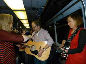 Photo: Mike singing accompanied by Kiri and Judy.