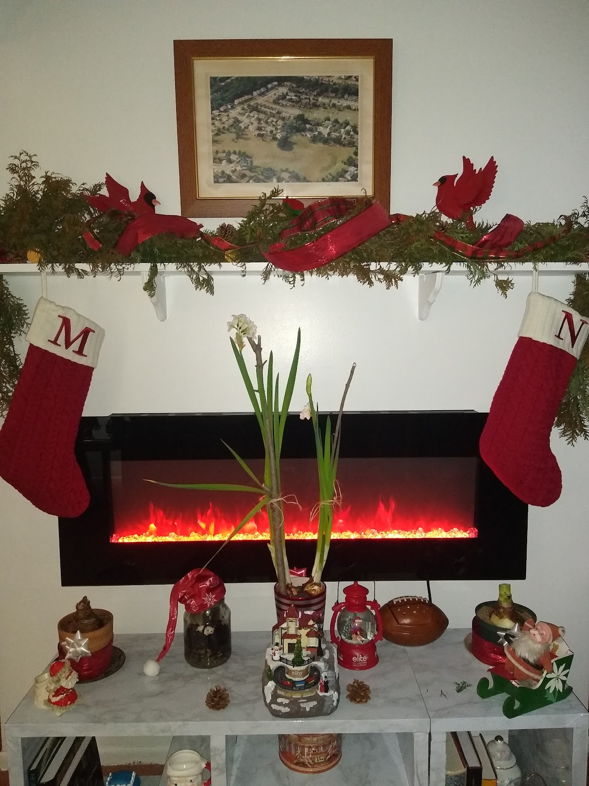 fresh DIY Christmas garland on fireplace mantle