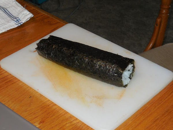 Run sharp knife under water and shake off excess.  Cut sushi roll in...