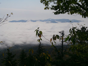 Photo: The Ossippee Mountains rising above the clouds.