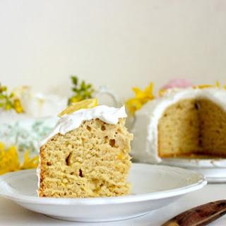 Vegan Lemon Cake Topped with Coconut Cream Frosting.