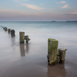 Youghal strand sunset 2 by John Holmes - Landscapes Beaches ( sky, waves, soothing, old, clouds, long exposure, sea, peacefull, eathered, rocks, beach, groynes, wood, coastal )