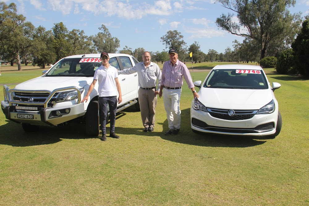 Narrabri Holden customer service assistant Bobby Parish, RSL Club chief executive Paul Gordon and Narrabri Holden sales manager Mike McGregor and the Narrabri Golf Club yesterday, with a Holden Colorado and a Holden Astra.