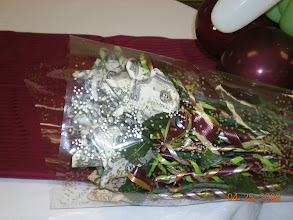 Photo: Long stem moneyroses wrapped in cellophane