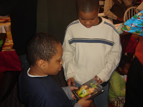 Photo: Chey'mon & Kameran look at their DVDs
