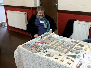 Photo: 005 Shirley Harper, a West Midlands Group stalwart and 009 Society member, accompanies husband Geoff to narrow gauge modelling events throughout the country with her craft stall. Good to see Shirley up and about again after a relatively recent illness .