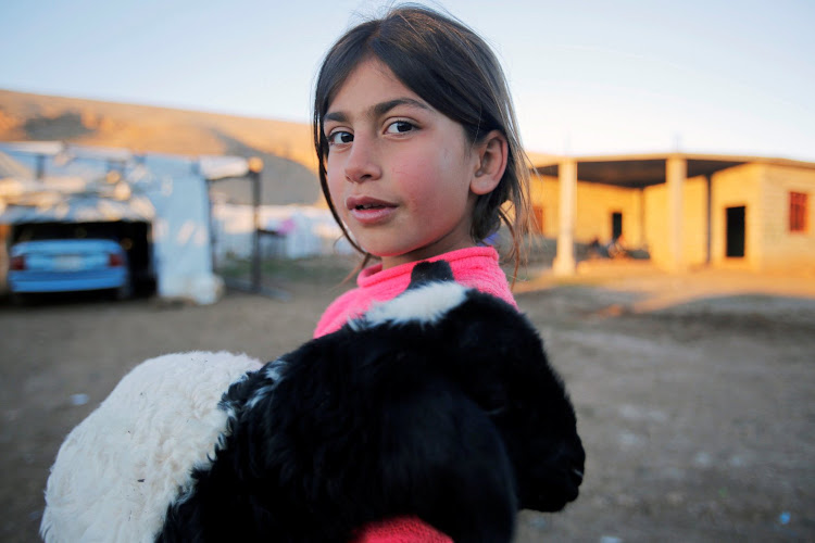 A Yazidi girl who was kidnapped by IS militants is at a refugee camp in Iraq.