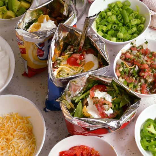 Fun And Easy Walking Tacos Are Perfect For Parties, Game Day, Movie Night, And Pool Parties.  Simply Set Up The Toppings And Let Your Guests Customize To Suite Their Taste.