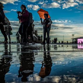 after the rain by Frans Scherpenisse - City,  Street & Park  Street Scenes ( blue, street, umbrella, lisbon, square, portugal, people, lisboa, rain )