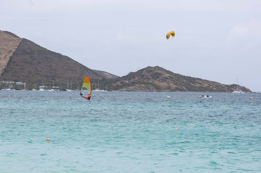orient-bay-water-sports.jpg - A sailboard slices the turquoise water of Orient Bay.