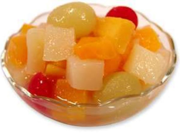 Drain all canned fruit very well.  Add all fruits - except bananas -...