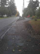 Photo: Looking east.  Here the sidewalk moves away from the street to make room for a planting strip.  SDOT will plant two trees in the near future.