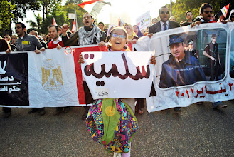 Photo: A girl leads a part of the march to Tahrir Square.