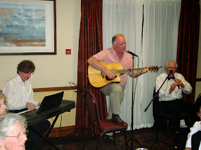 Photo: Harry Carpendale on keyboard, Michael McLaughlin on guitar and Tom Kirby on tin whistle.  Entertainment at its best.