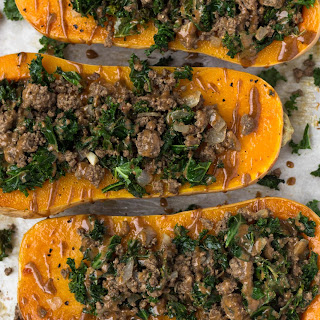 Kale & Beef Stuffed Butternut Squash with Cinnamon Tahini Sauce.