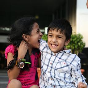 Children in their mischievous best. by Manoj Ojha - Babies & Children Children Candids ( dubai mall, dubai, children, candid, burj khalifa, mischievous, natural )