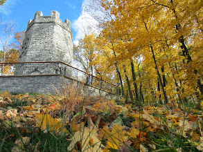 Photo: Fall leaves scattered at the base of a stone tower at Hills and Dales in Dayton, Ohio.