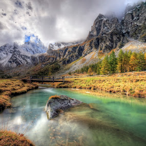 Clouds and sun over the high pastures by Alessandro Franzini - Landscapes Mountains & Hills ( clouds, alpe devero, emerald, creek, alps )