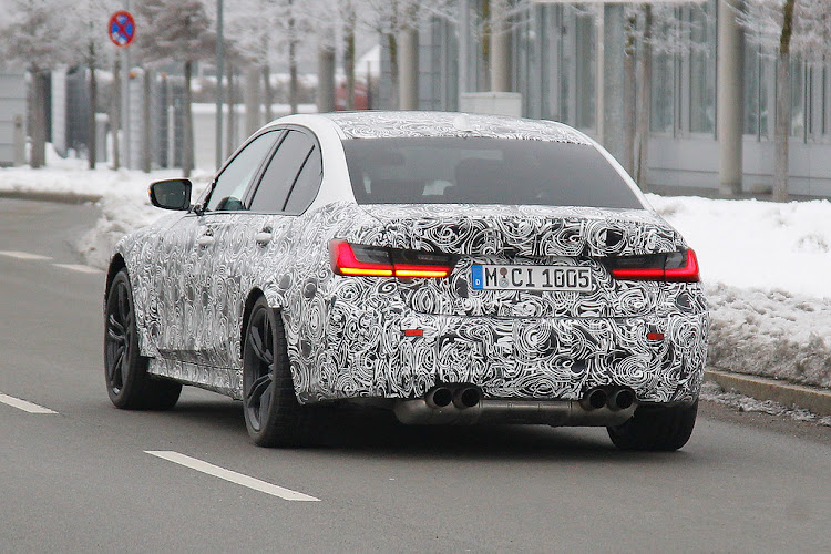 The quad exhausts reveal this to be the new M3 underneath the disguise. Picture: SPIEDBILDE/BRIAN WILLIAMS