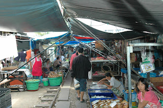 Photo: This local food market is outside of Kanachanaburi, Thailand.  There are hundreds of vendors.  The market is built around the railroad tracks seen here....