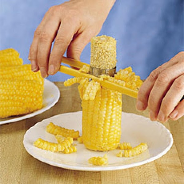 Cut kernels off of fresh, raw, corn cobs into a large bowl.