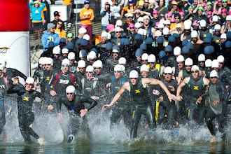 Photo: Bang, the collegiate men dash into the lake.