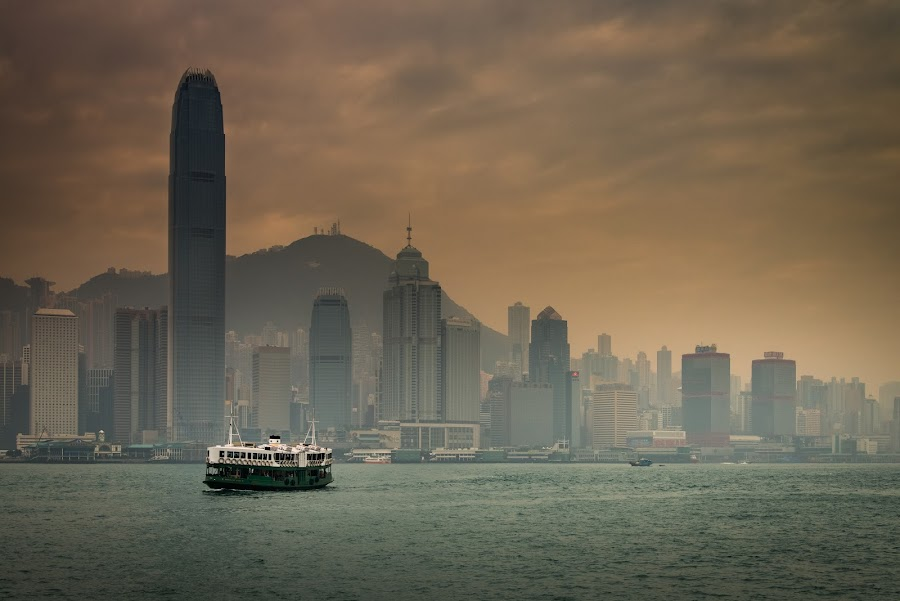 Ferry cruising in victoria harbour by Natapong Paopijit - City,  Street & Park  Vistas ( building, star, hk, skycrapers, travel, cityscape, landscape, cruise, city, urban, sky, ferry, fog, scene, cloudy, victoria, misty, mist )