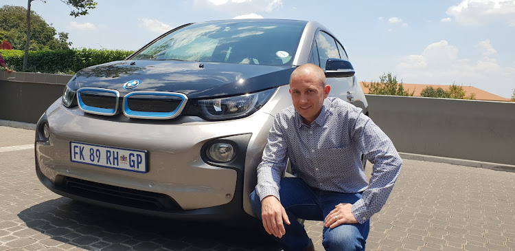 Shaun Maidment with his i3, in which he covers up to 4,000km per month. Picture: DENIS DROPPA