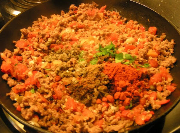 Combine meat and sauteed vegetable; add cummin, smoked paprika, cilantro, parsley and caper. Add...