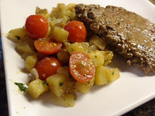 Add tomatoes and parsley to potatoes.  Stir and heat one minute.  Turn...