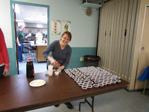 Photo: Lisa Cameron preparing the syrup for the pancakes!!