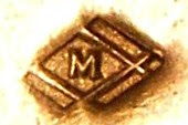 Photo: M in diamond mark found on brass mountings of jewelry. Quality seems fairly decent.