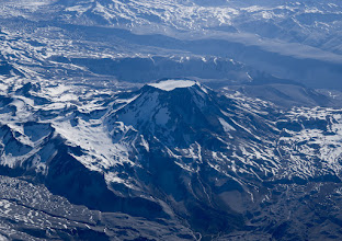 Photo: Volcanos on a flight south from Santiago