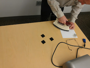 Photo: Ironing on the bits of transparency to complete mazes.