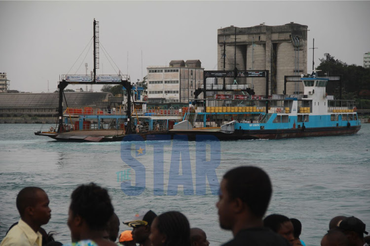 MV Harambee being towed to shore by MV Likoni after it stalled in 2015 at the Likoni Channel.