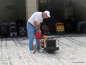 Photo: Mike Alexander adding gasoline to Case Alexander's speeder.  He never had time to run it.   HALS Public Run Day  2016-0716  RPWhite