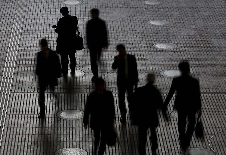 People walk at an office building at a business district in Tokyo, Japan. February 29 2016 Picture: REUTERS/YUYA SHINO