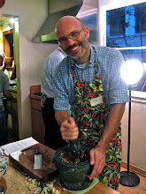 Photo: Giorgio pounding the chillies with garlic