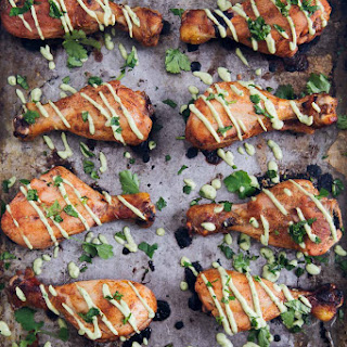 Baked Peruvian Chicken Drumsticks with Avocado Lime Dipping Sauce.