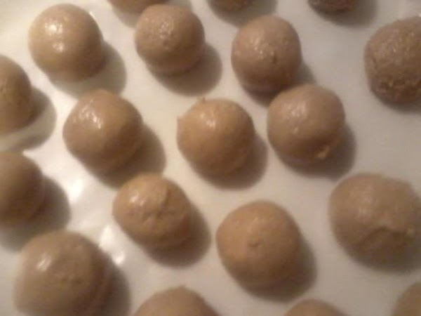 Mix together the pb and fluff roll into bite size balls. Place on wax...