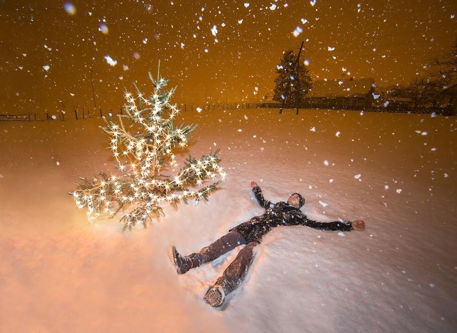 Everlasting Moment by Srdjan Vujmilovic - Public Holidays Christmas ( orange, self-portrait, person, green, land, white, landscape, portrait, shadows, snowing, hat, lights, time, winter, tree, cold, snow, weather, long exposure, christmas tree, light, coat,  )