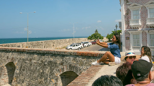 atop-platforma-de-ballestas.jpg - A young woman takes a photo atop the Platforma de Ballestas seawall in Cartagena, Colombia.