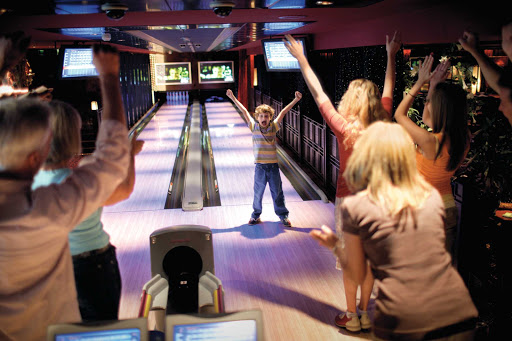 Go bowling with the family during your cruise on Norwegian Bliss.